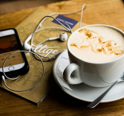 Listening to podcasts with a cup of coffee. Photo by Juja Han on Unsplash