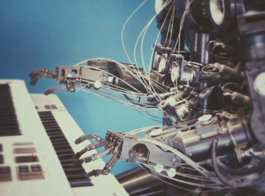 Robot art: robot playing a musical keyboard. Photo by Franck V. on Unsplash