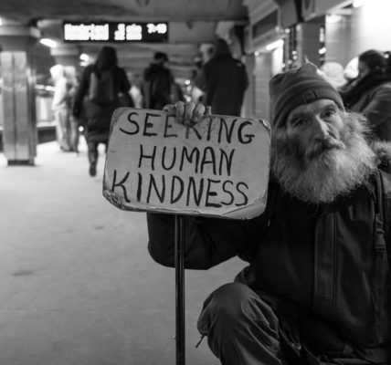 Homeless man seeking human kindness. Photo by Matt Collamer on Unsplash