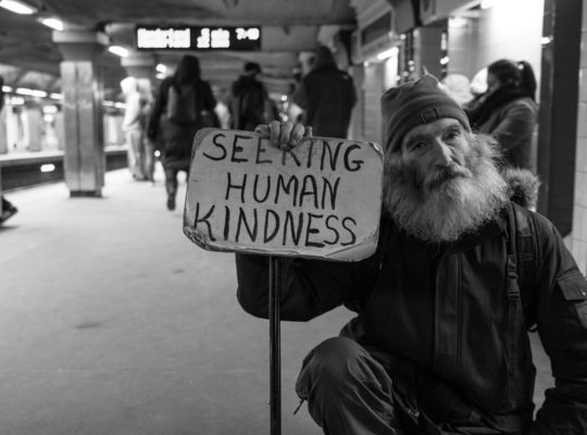 Homeless man seeking human kindness. Photo by Matt Collamer on Unsplash