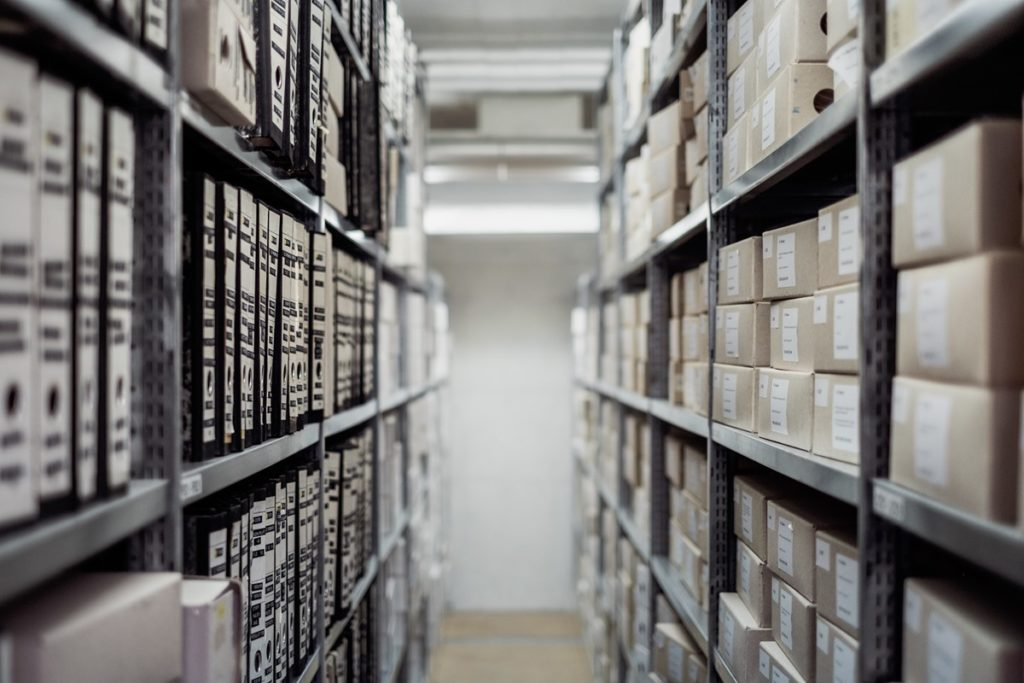 Archive shelves. Photo by Samuel Zeller on Unsplash