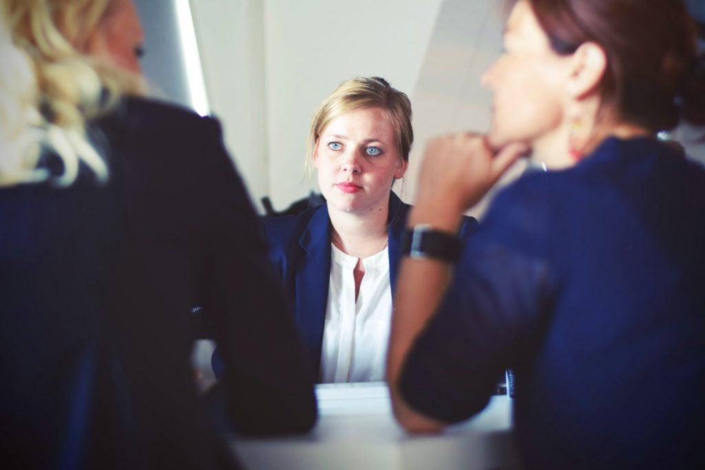 Academic job interview. Photo by Tim Gouw on Unsplash