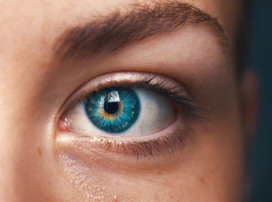 Gender and AI. Close of up a human eye. Photo byAmanda DalbjörnonUnsplash