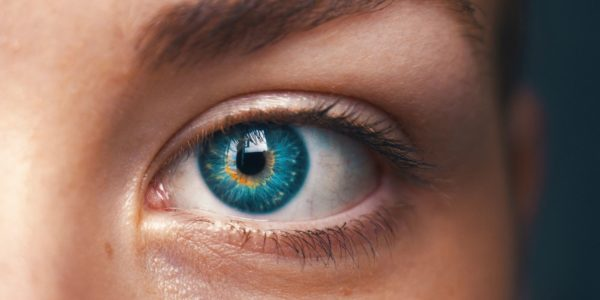 Gender and AI. Close of up a human eye. Photo by Amanda Dalbjörn on Unsplash
