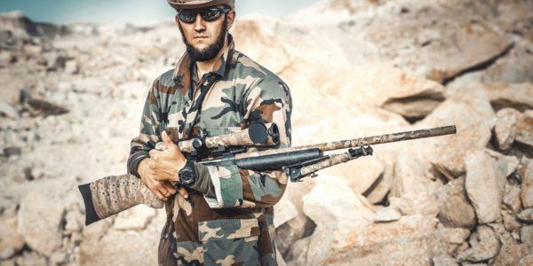 Irregular warrior: unmarked soldier with rifle. Photo byMaxim PotkinonUnsplash