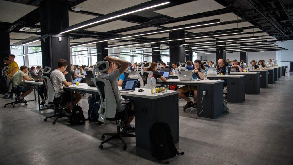 Workplace surveillance: open plan office. Photo by Alex Kotliarskyi on Unsplash.